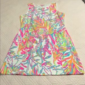 Lilly Pulitzer neon shift with open back.